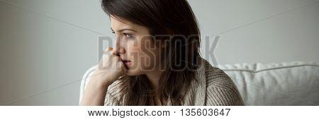 Portrait of a melancholy women sitting alone