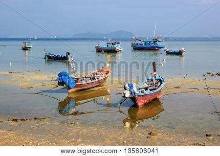 Long-tail boats at low tide, Rawai beach, Phuket, southern Thailand