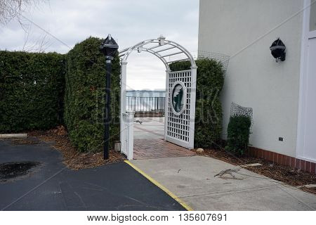 HARBOR POINT, MICHIGAN / UNITED STATES - DECEMBER 24, 2015: One must pass under an arbor to enter the lakefront patio of the Harbor Point Clubhouse.