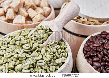 Coffee beans and coffee ingredients in wooden barrels