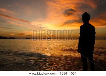 Silhouette Of Man At Sunset On The Beach