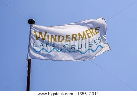 CUMBRIA UK - MAY 29TH 2016: A flag promoting Lake Cruises on Lake Windermere in the Lake District on 29th May 2016.
