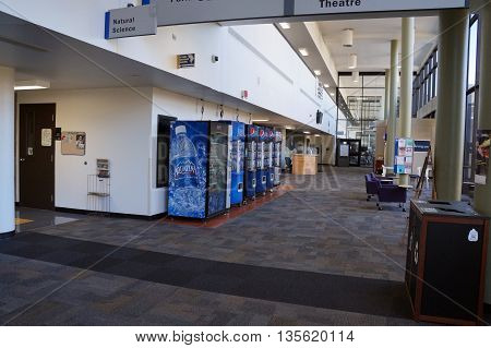 JOLIET, ILLINOIS / UNITED STATES - OCTOBER 25, 2015: Vending machines offer soft drinks in the hallway at Joliet Junior College.