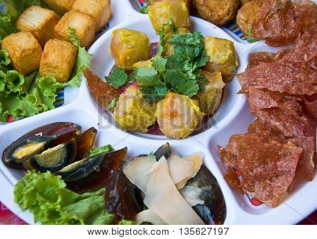 hors-d'oeuvre with eggs, Chinese snacks, vegetables pork