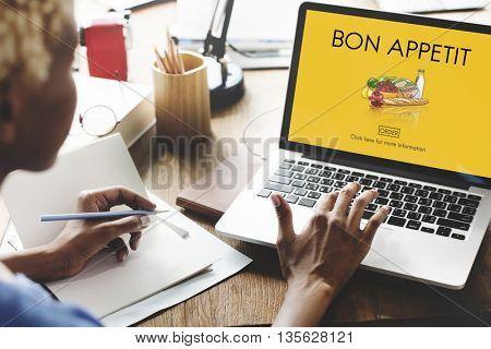 Woman Bon Appetit Graphic on Laptop Concept