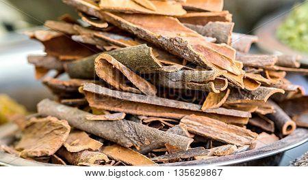Cinnamon sticks bowl at a market in Old Delhi