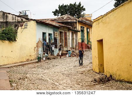 Trinidad Cuba - January 14 2016: Typical scene of one of streets in the center of Trinidad Cuba - colonial architecture people walking around