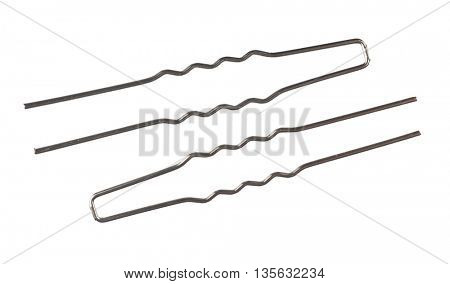 Black metal hairpins isolated on white