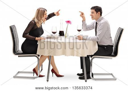 Angry couple arguing with each other on a date at a restaurant isolated on white background