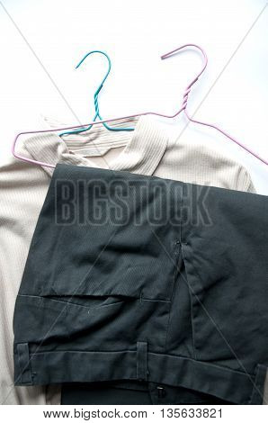 clothes on the coat hanger on white background