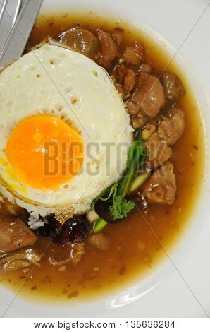 Fried rice with egg and pig on a plate