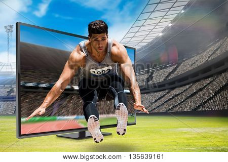 Front view of sportsman is jumping against view of a stadium