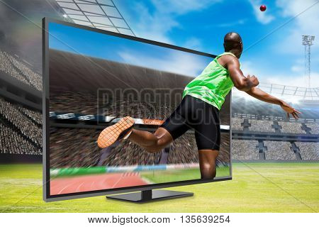 Rear view of sportsman throwing a shot against view of a stadium