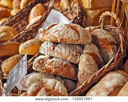 Basket of fresh baked  bread on a market stall