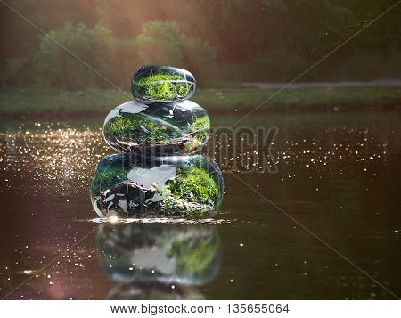 Transparent stones in water Zen pyramid. Stones of the volume inside the stones nature flowers. Concept - peace of mind inner peace harmony environment poster