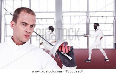 Close-up of swordsman holding fencing sword against gym