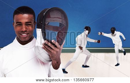 Swordsman holding fencing mask against digitally generated image of bicolored background