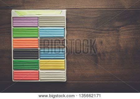 multicolored plasticine bars on the wooden table