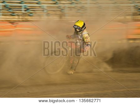Rivne Ukraine - 29 August 2015: Unknown rider overcomes the track at the Open Cup Speedway to the day of the city Rivne