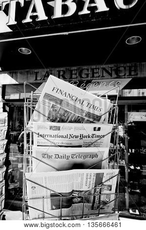 STRASBOURG FRANCE - JUN 24 2016: International New York Times Financial Times The Daily Telegraph and other major newspapers headline titles at press kiosk about the Brexit referendum in United Kingdom which has decided the country wishes to quit the Euro