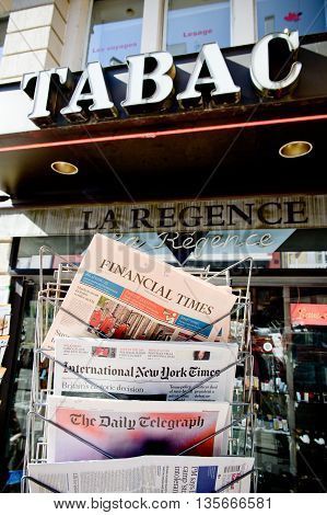 STRASBOURG FRANCE - JUN 24 2016: International New York Times Financial Times The Daily Telegraph and other major newspapers headline titles at press kiosk about the Brexit referendum in United Kingdom which has decidedthe country wishes to quit the Europ