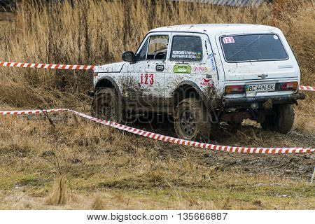 Lviv Ukraine - February 21 2016: Off-road vehicle brand VAZ - NIVA (No. 123) overcomes the track on a amateur competitions Trial near the city Lviv Ukraine