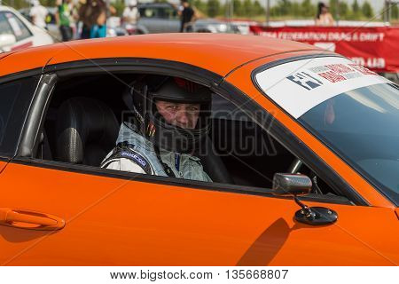 VinnytsiaUkraine-July 26 2015: Pilot of drag racing car prepares for the races of the Drag championship of Ukraine on July 262015 in Vinnytsia Ukraine.