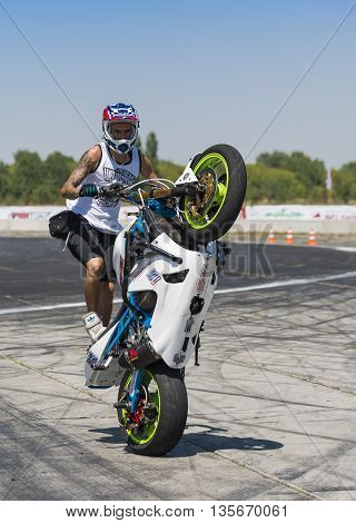 Vinnytsia Ukraine-July 25 2015: Unknown stunt biker entertain the audience before the start of the championship of drifting on July 252015 in Vinnytsia Ukraine.