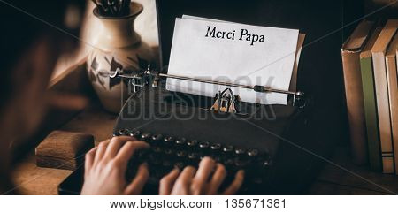 Merci papa written on paper with typewriter