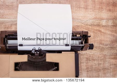 Meilleur papa pour toujours written on paper with typewriter