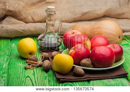 Natural Food With Flagon On Green Wood