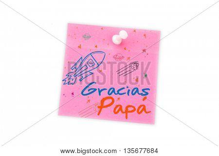 Word gracias papa against digital image of pushpin on pink paper