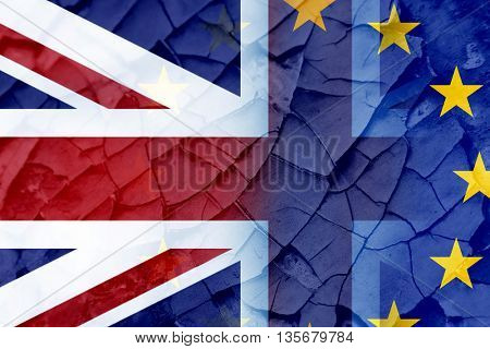 Unon Jack flag and EU flag painted on cracked wall as Britain decides to leave the EU