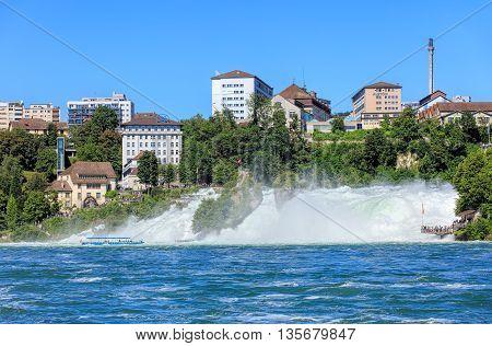 Neuhausen am Rheinfall, Switzerland - 22 June, 2016: the Rhine Falls. The Rhine Falls (German: Rheinfall) is the largest plain waterfall in Europe located on the Rhine river in Switzerland.