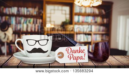 Danke papa message next to coffee on a wooden desk