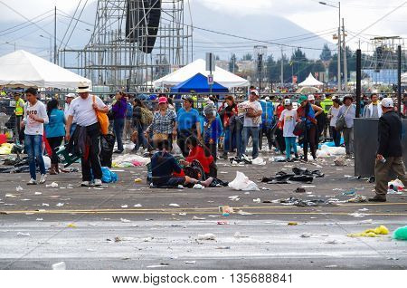 QUITO, ECUADOR - JULY 7, 2015: After pope Francisco mass event, people trying to get out. Rainning is comming, tends on the street.