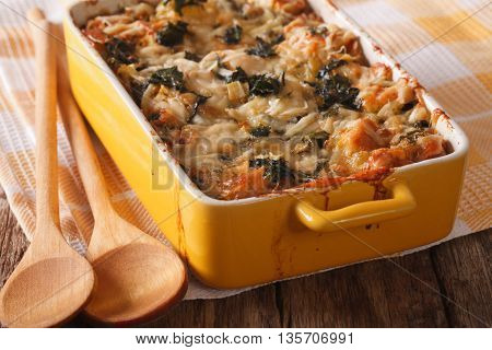 Strata Casserole With Spinach, Cheese And Bread Close Up. Horizontal