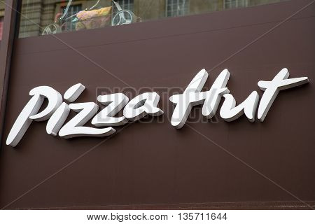 LONDON UK - MAY 7TH 2016: The logo of a Pizza Hut outlet in central London on 7th May 2016.