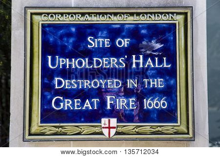 LONDON UK - MAY 4TH 2016: A plaque marking the site of Upholders Hall which was destroyed in the Great Fire of London taken on 4th May 2016.
