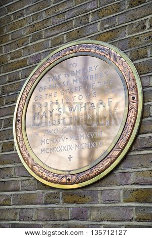 A golden memorial plaque dedicated to members of staff of the proprietors of Hays Wharf in London who lost thie lives during the two Great Wars.