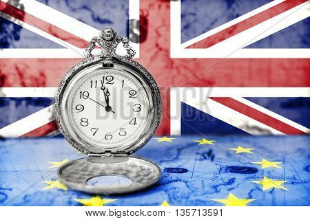 Brexit. Flags of the United Kingdom and the European Union and clock close to twelve o`clock.