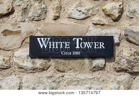 A plaque marking the iconic White Tower at the Tower of London. The tower was built by William the Conqueror during the 1080s.