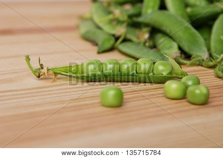 Green Peas In Pods Freshly Picked On Wooden Background Texture