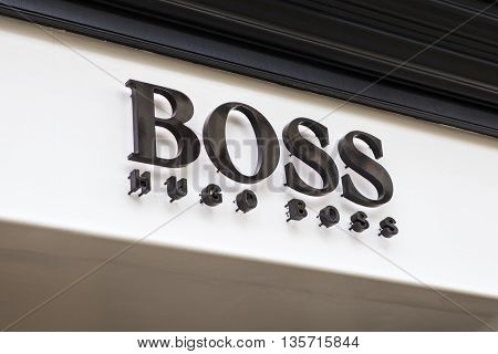 CAMBRIDGESHIRE UK - APRIL 8TH 2016: A sign for a Hugo Boss fashion retail store in Cambridge on 8th April 2016.
