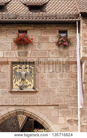 NURNBERG /GERMANY - JULY 17th 2014: photo of double headed crowned vulture imperial sign embedded in building wall