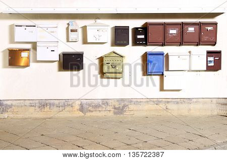A bundge of postboxes / mailboxes / letterboxes photographed by night with bulb exposure.