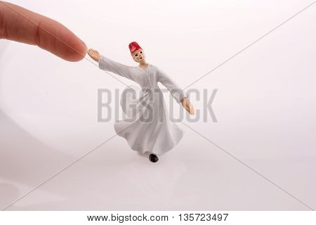 Hand holding a Sufi Dervi? on a white background poster