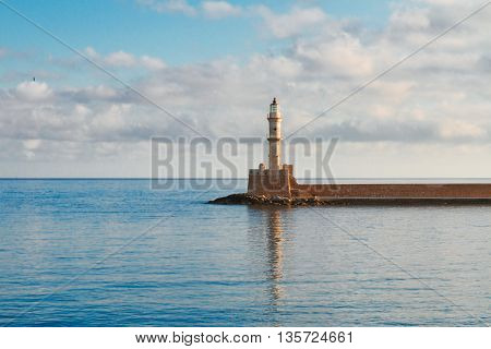 bay of Chania with watrs of Aegan sea and lighthouse at sunny summer morning, Crete, Greece