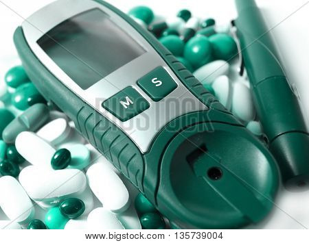 Device for measuring blood sugar level and pills  in green version