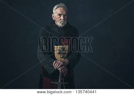 Senior Knight In Hauberk Standing With Sword.